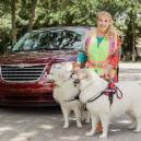 Jo-Anna Hehir with her two Great Pyrenees deliver packages for Amazon Flex
